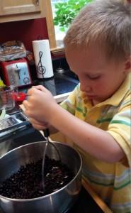 Aaron smashing huckleberries